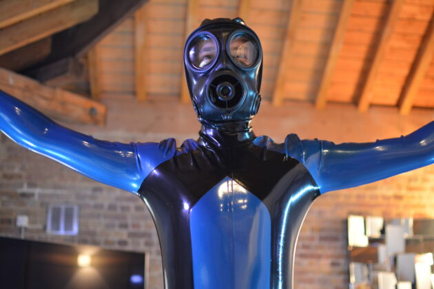 front from below view bgslave in gas mask and full rubber suit from libidex