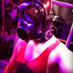 switchLDN in red and semi trans latex rubber wrestling suit - close up selfie