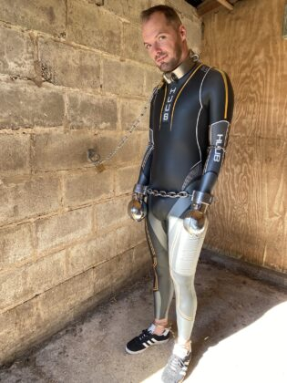 Switch standing in Huub wetsuit with Parus collar and metal fist mitts