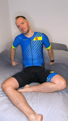 Switch laying back in Castelli Free Sanremo Tri Suit legs crossed