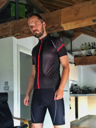 Switch in Sportful carbon and red jersey with plain black lycra cycle shorts