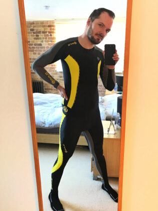 Switch in Skins yellow and black full lycra from the front